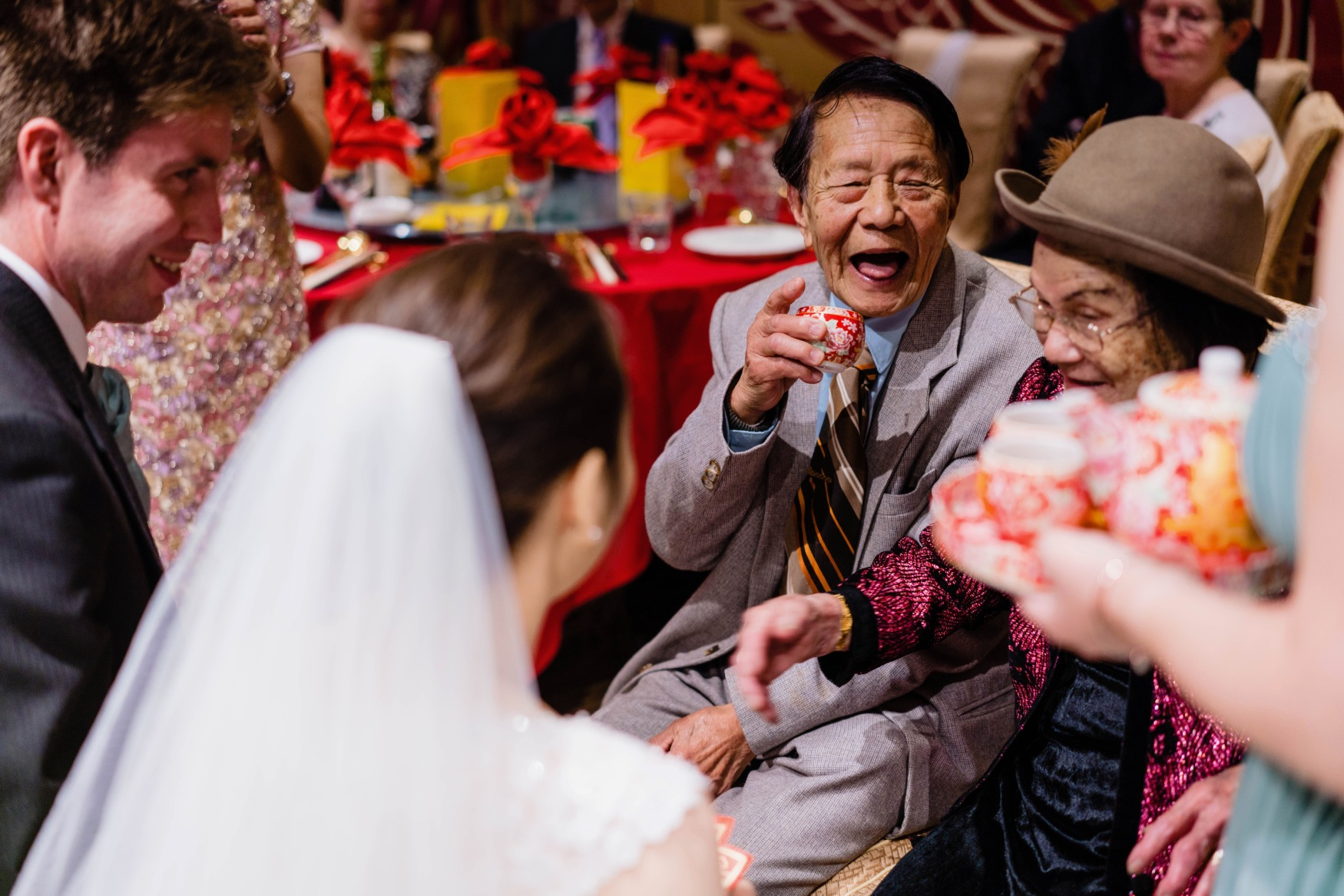 Granddad receiving tea in the tea ceremony during my wedding in 2018
